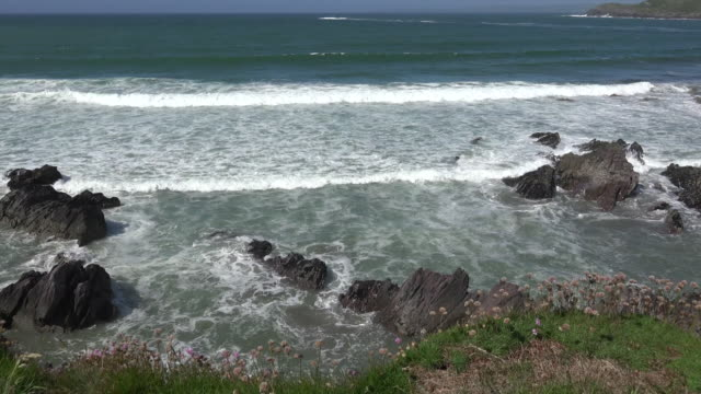 ireland west cork coastal view with waves zoom and pan - county cork stock videos & royalty-free footage
