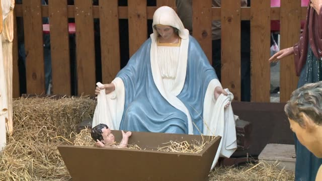 irgin mary and baby jesus in nativity scene at daley plaza on november 30, 2013 in chicago, illinois - nativity scene stock videos & royalty-free footage