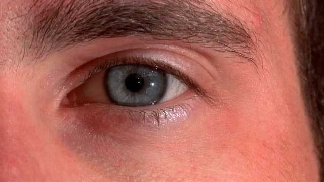 iris closing in slow motion - cornea stock videos & royalty-free footage