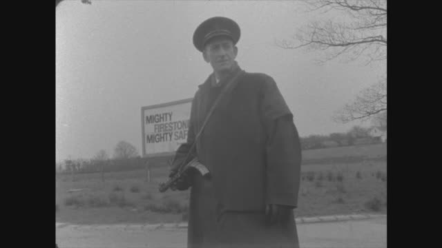 newry customs post a) armoured car at border: on verge ditto: police check cars bv ditto bv policeman with sten gun: in road: track passed l-r av... - nordirland stock-videos und b-roll-filmmaterial