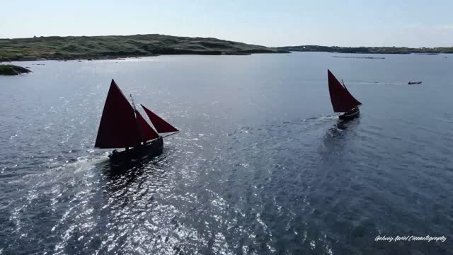 irish drone footage captures this gathering of galway hooker boats, a traditional fishing boat that was developed for the strong seas in the area.... - raw footage stock videos & royalty-free footage
