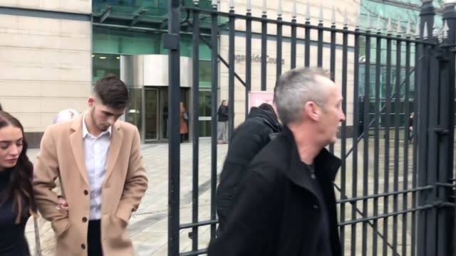 irish league footballer jay donnelly leaves court after receiving a four month prison sentence for sharing an indecent image of a child - sportliga stock-videos und b-roll-filmmaterial