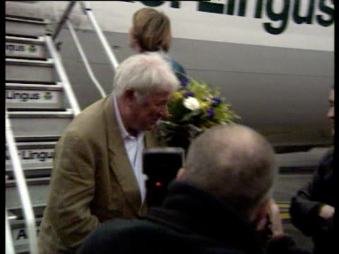 irish poet seamus heaney arriving at dublin airport greeting his family and taoiseach john bruton after announcement of his winning novel prize for... - literatur stock-videos und b-roll-filmmaterial