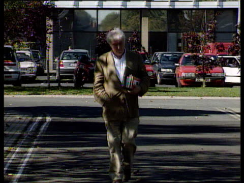 irish poet seamus heaney walking towards camera in car park carrying books under his arm 08 oct 95 - poet stock videos & royalty-free footage