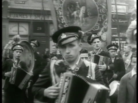 irish police standing by armored car . northern irish people marching in street parade w/ british royalty banners. loyalists to the crown of england... - northern ireland stock videos & royalty-free footage