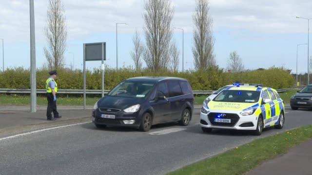irish police stop motorists at checkpoints, looking for travellers who might be making non-essential journeys during the coronavirus lockdown - maynooth stock videos & royalty-free footage