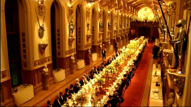 berkshire windsor castle int queen elizabeth ii and irish president michael dhiggins along for state banquet higgins taking seat banquet seen from... - queen royal person stock videos & royalty-free footage