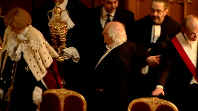 Guildhall banquet Fanfare and mace bearer leads Michael D Higgins and wife Sabina Coyne enter and procession to seat as diners clap / all sit /...