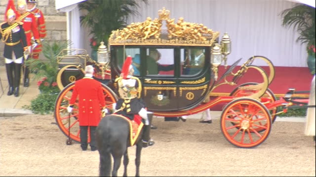 irish president state visit: windsor castle procession; carriage arriving and british national anthem played sot / higgins and queen from carriage... - peerage title stock videos & royalty-free footage