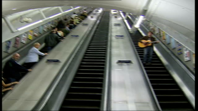 irish singer songwriter writes entire album about the tube england london int commuters along up escalator of tube station pan chris singleton... - fretboard stock videos & royalty-free footage