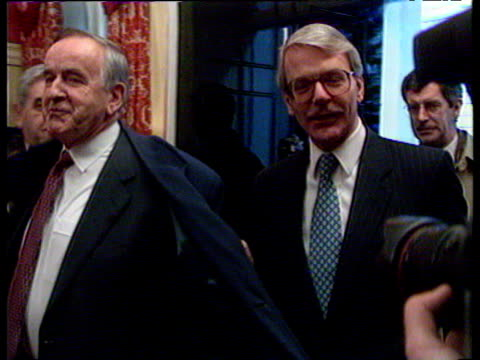 irish taoiseach albert reynolds and us senator dick spring enter 10 downing st with prime minister john major angloirish declaration 15 dec 93 - minister clergy stock videos and b-roll footage