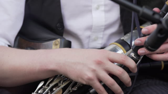 Irish Uilleann Piper Performing On Stage Close-up (4K/UHD)