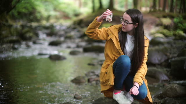 irl Explorer Inspecting a Water Sample in a Beaker for STEM research