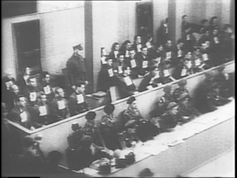 irma grese and other female prisoners enter courtroom / british military court officials taking their seats in the courtroom / male prisoners lining... - number 9 stock videos & royalty-free footage