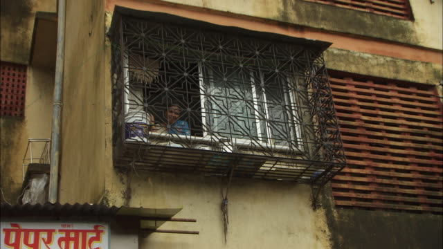 iron bars cover windows on a derelict apartment building in mumbai, india. available in hd. - iron bars for windows stock videos & royalty-free footage