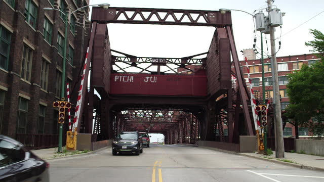 iron drawbridge in industrial section of chicago - drawbridge stock videos and b-roll footage