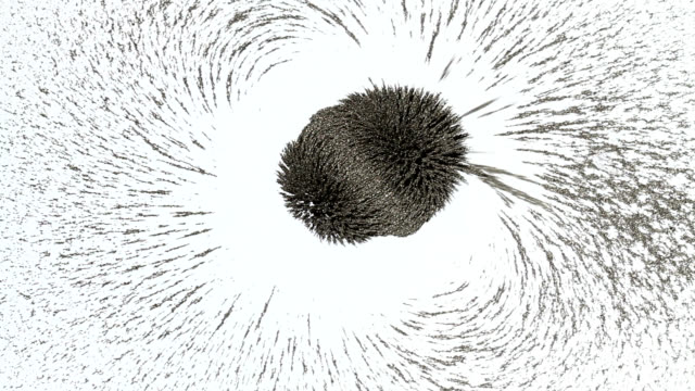 iron filings in a magnetic field - magnetism stock videos & royalty-free footage