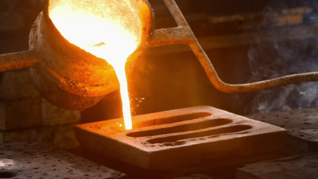 iron is cast using sand moulds - news event stock videos & royalty-free footage