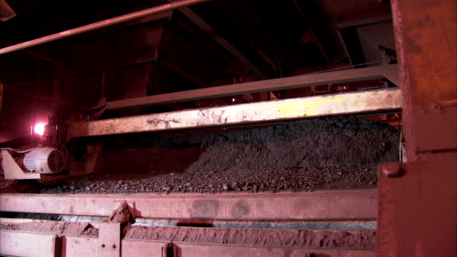 iron ore flows through an indurating machine. - iron ore stock videos & royalty-free footage
