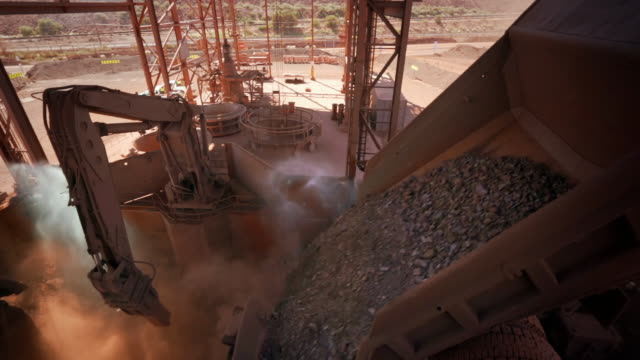 iron ore is poured from a truck creating dust - construction vehicle stock videos & royalty-free footage