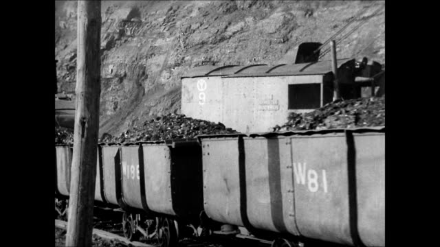 iron ore mines mountain side fushun china. train loads of ore passing. mine shaft loading slide. japanese mine workers carrying baskets refinery bg.... - mineral stock videos & royalty-free footage