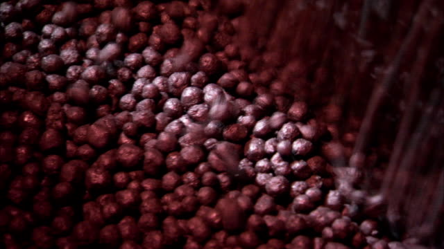 iron ore pellets fall into a pile. - iron ore stock videos & royalty-free footage