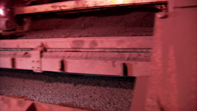 iron ore pellets shake down an indurating machine. - iron ore stock videos & royalty-free footage