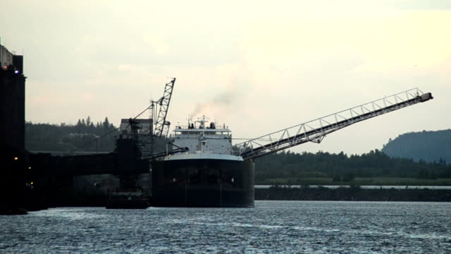 iron ore ship being loaded - industrial sailing craft stock videos & royalty-free footage