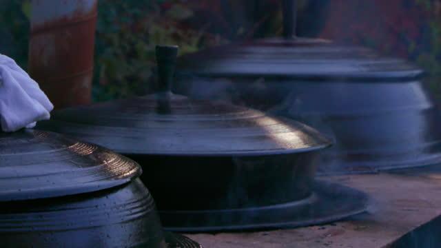 iron pot steaming at baegyangsa temple in naejangsan mountain / jangseong-gun, jeollanam-do, south korea - small group of objects stock videos & royalty-free footage
