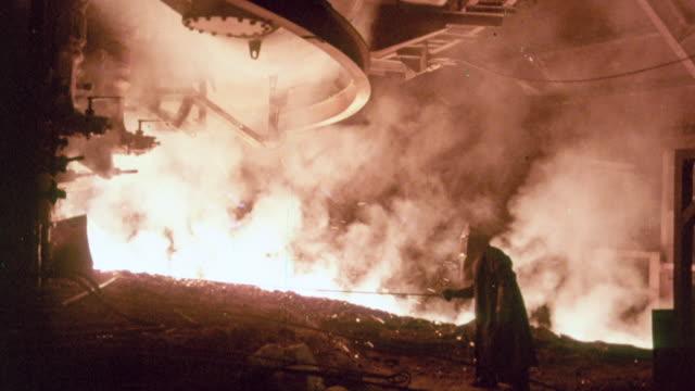 montage iron workers pouring molten metal / united kingdom - järn bildbanksvideor och videomaterial från bakom kulisserna
