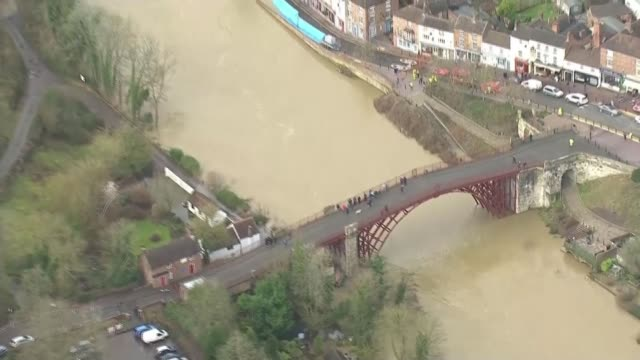 ironbridge and bewdley residents evacuated as flood defences breached; england: shropshire: ironbridge: ext air view shots of bridge and wide shot of... - ironbridge shropshire stock videos & royalty-free footage