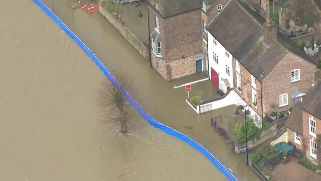 ironbridge and bewdley residents evacuated as flood defences breached; england: shropshire: ironbridge: ext air view shots of breached flood defences. - ironbridge shropshire stock videos & royalty-free footage