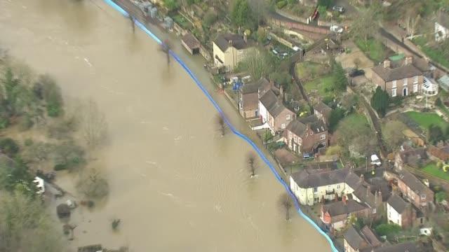 ironbridge and bewdley residents evacuated as flood defences breached; england: shropshire: ironbridge: ext air view shots of river breaching flood... - ironbridge shropshire stock videos & royalty-free footage