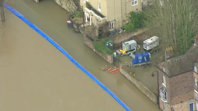 ironbridge and bewdley residents evacuated as flood defences breached; england: shropshire: ironbridge: ext air view blue flood defence barrier... - navy stock videos & royalty-free footage