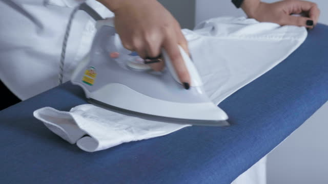 ironing housework - iron appliance stock videos & royalty-free footage
