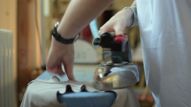 ironing in workshop - アイロン台点の映像素材/bロール