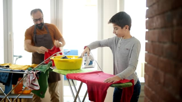ironing is fun - lavori domestici video stock e b–roll