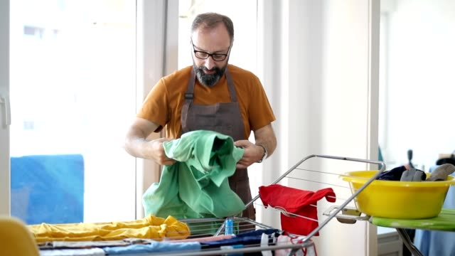 ironing time - housework stock videos & royalty-free footage