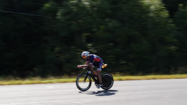 ironman 70.3 men bike race - athlete stock videos & royalty-free footage