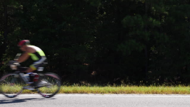 ironman 70.3 men bike race - blurred motion stock videos & royalty-free footage