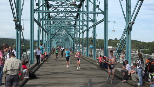 ironman running crossing the bridge in chattanooga, tn, the 2015 top ranked america outdoor living city - chattanooga stock videos and b-roll footage