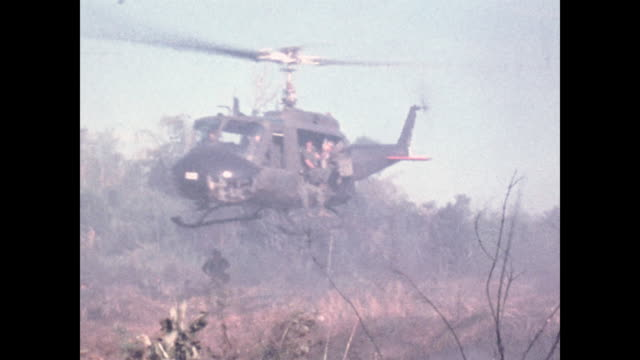 iroquois filled with soldiers takes off from clearing in the bush. - vietnam war stock videos & royalty-free footage