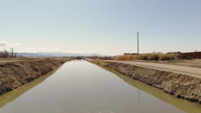 irrigation canal in western usa water sourced from the colorado river 4k aerial video - irrigation equipment stock videos & royalty-free footage