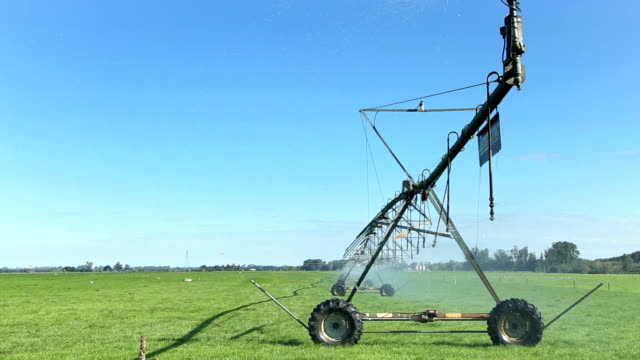 irrigation machine on meadow in blue sky - agricultural machinery stock videos & royalty-free footage