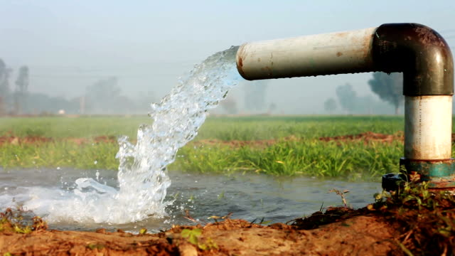 irrigation pipe with flowing water - irrigation equipment stock videos & royalty-free footage