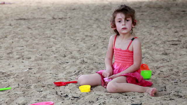irritated little girl looks around on the beach - red dress stock videos & royalty-free footage