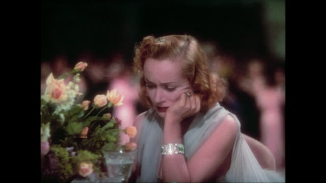 1937 irritated woman (carole lombard) loses patience with stalking press photographer - kamera blitzlicht stock-videos und b-roll-filmmaterial
