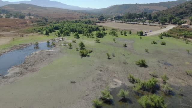 irvine, ca, u.s., - aerial view of irvine lake on monday, aug 19, 2019. - irvine california stock videos & royalty-free footage