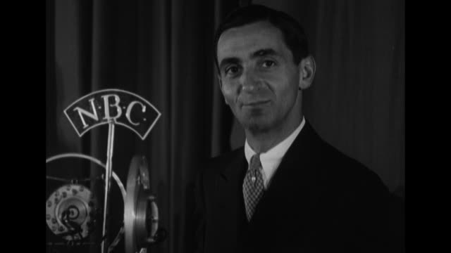 irving berlin speaks into nbc radio microphone and fools around with four other men one with a conductor's baton closeup of berlin / note exact... - nbc stock videos & royalty-free footage