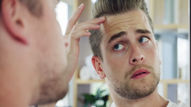 is that the start of a receding hairline? - grooming stock videos & royalty-free footage